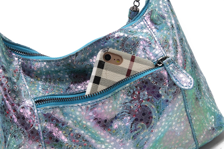 Shining genuine leather shoulder bag with a peacock motif.